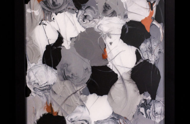This painting on glass uses metallic colors of silvers, whites, grays, and rusts in abstract orb shapes.