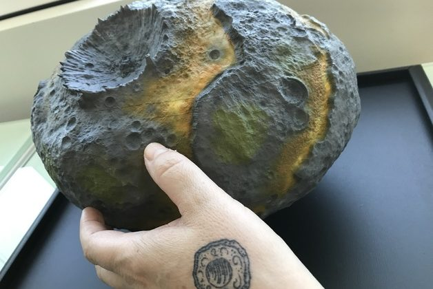 Large painted 3-D model of the Psyche Asteroid