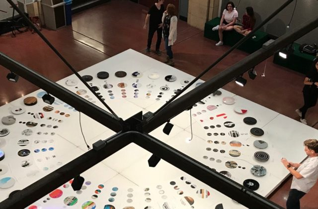 This image taken from a floor above shows dozens of clocks created by graphic design students at ASU, including some clocks representing Psyche.