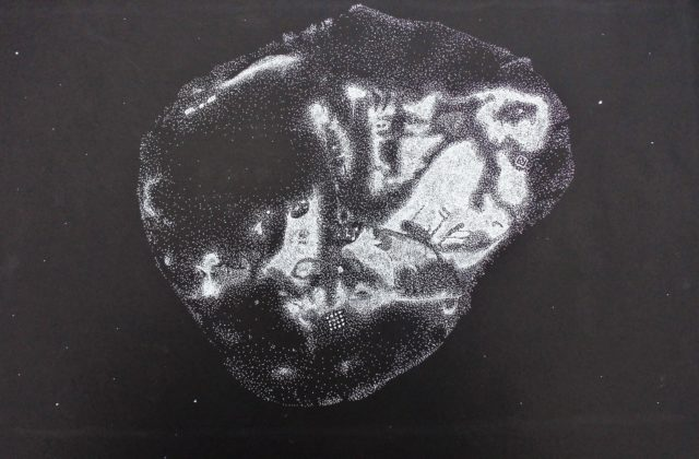 This image shows a black paper background onto which has been painted an artist's rendition of the Psyche asteroid using thousands of tiny white dots.