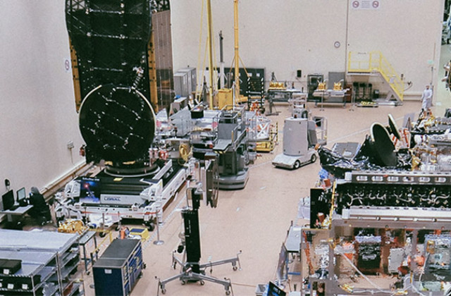 This image shows the high bay at Maxar where spacecraft are assembled.