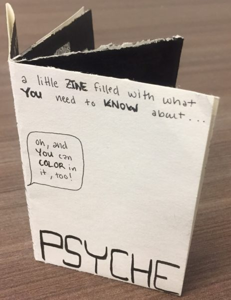 This image shows the Psyche zine folded up into an eight-page black and white miniature book.