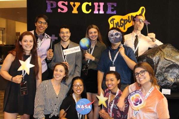 This image shows a subset of the Psyche Inspired interns in front of the Psyche Inspired Showcase photo booth.