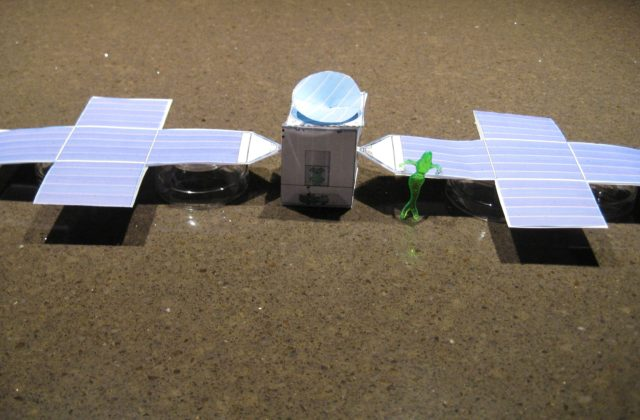 A paper model of the psyche spacecraft.