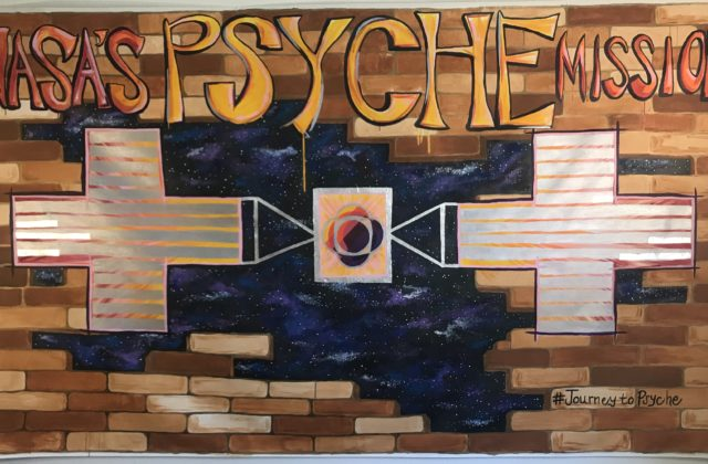 Psyche spacecraft breaking through a brick wall, opening to a vast and colorful universe.