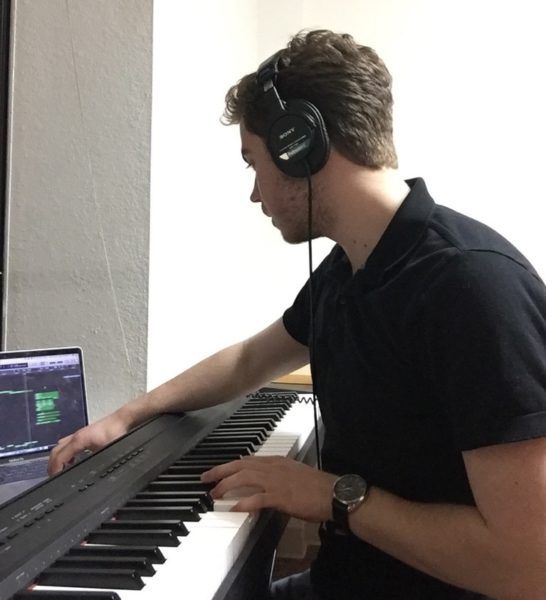 this image is of our Psyche Inspired intern Ryan Powell who playing the piano and editing his music of his computer.