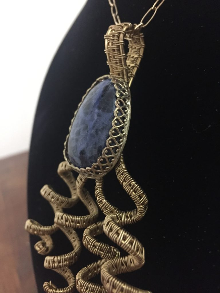 Sodalite stone with brass wire wrapped spiral embellishments.