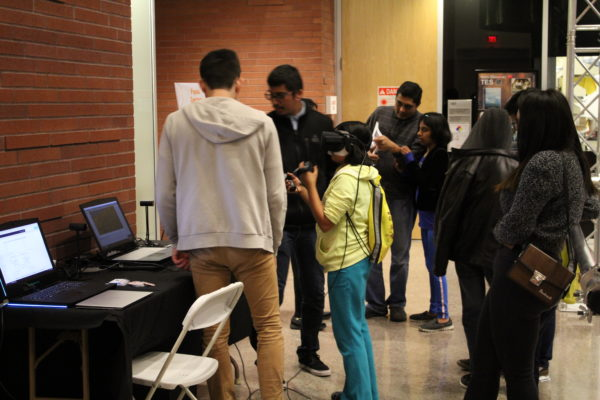 This image shows a child using an Oculus Rift to try the Space Object VR experience.