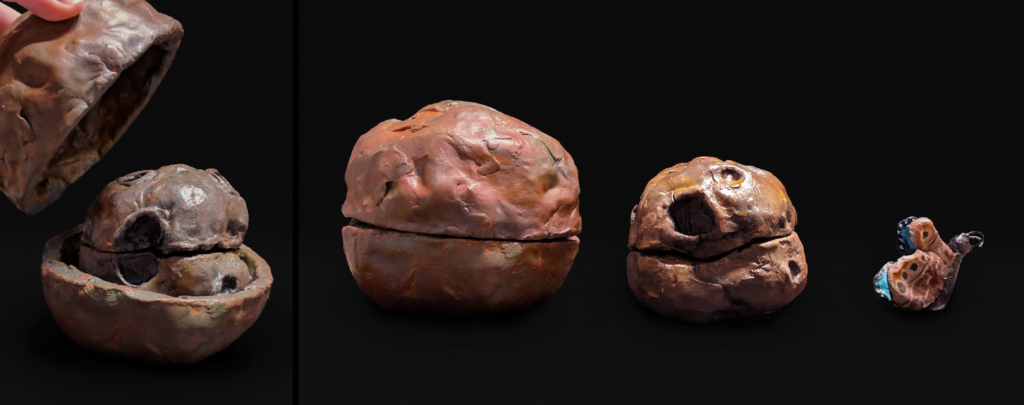 Three sculptures in a row on a black background. The sculpture on the far left is a sphere-like in shape and is painted various shades of brown, it is a planet. It has a seam through the middle. The middle sculpture is more irregular in shape and has craters. It is painted more silver with hints of yellow, it also has a seam through the middle. The sculpture on the far right is of a butterfly. Its wings are up and the outside of the wing is painted various shades of brown with black spots at the top. You can see a little bit of the inside of the wing which is bright blue.