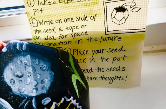 This image shows a multi-sided garden pot painted with images of Psyche and other natural elements. Instructions for adding a note to the pot are written alongside.