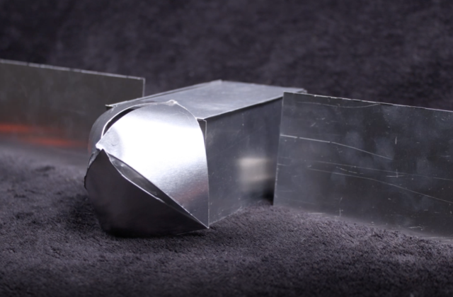 a small model of the psyche spacecraft made of thin metal.