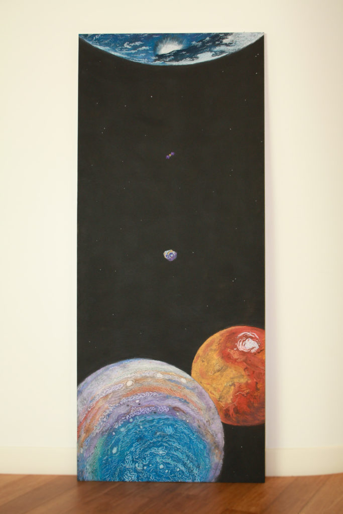 """Falling"" is composed of pastel on a black sheet of wood. It is 6ft tall and 2ft wide. Most of the painting is black with a few scattered stars. Immense planets are found at the ends of the scene. A small purple and gold craft falls away from Earth at the top of the painting and down toward an equally miniscule target: 16-Psyche. This asteroid sits at the center of the painting, floating between Jupiter and Mars."