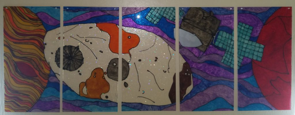 Consisting of five panels mimicking stained glass, this piece depictions the Psyche asteroid and her orbiter with Mars and Jupiter on each side. Light can pass from either direction, creating projections on surrounding surfaces. One side is smooth and the other textured. This piece can function multiple ways, symbolizing the many possibilities we can learn from the Psyche mission.