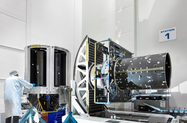 A technician prepares to integrate part of the electric propulsion system onto the main body of NASA's Psyche spacecraft at Maxar Technologies in Palo Alto, California.