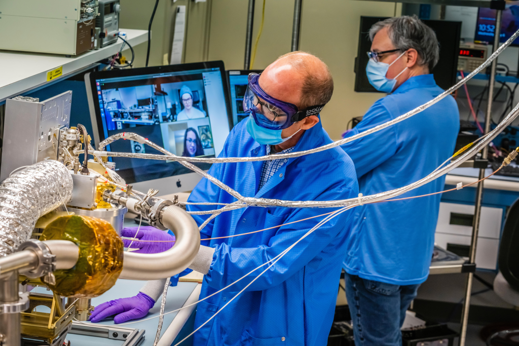 Engineers at the Johns Hopkins Applied Physics Laboratory in Laurel, Maryland, make progress on the spectrometer for NASA's Psyche spacecraft, while observing COVID-19 safety procedures.