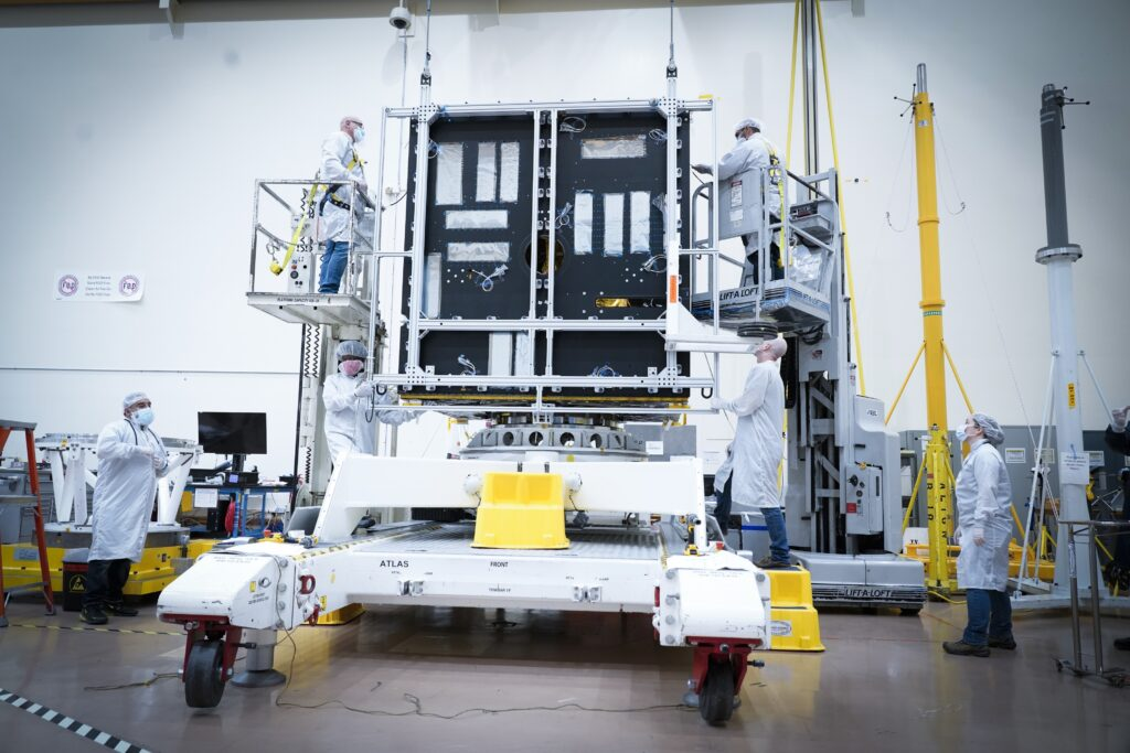 Scientists and engineers are working on the body of the Psyche spacecraft.