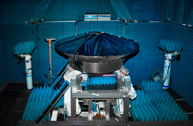 This image is of Psyche's high gain antenna which is black and in surrounded by blue insulation.