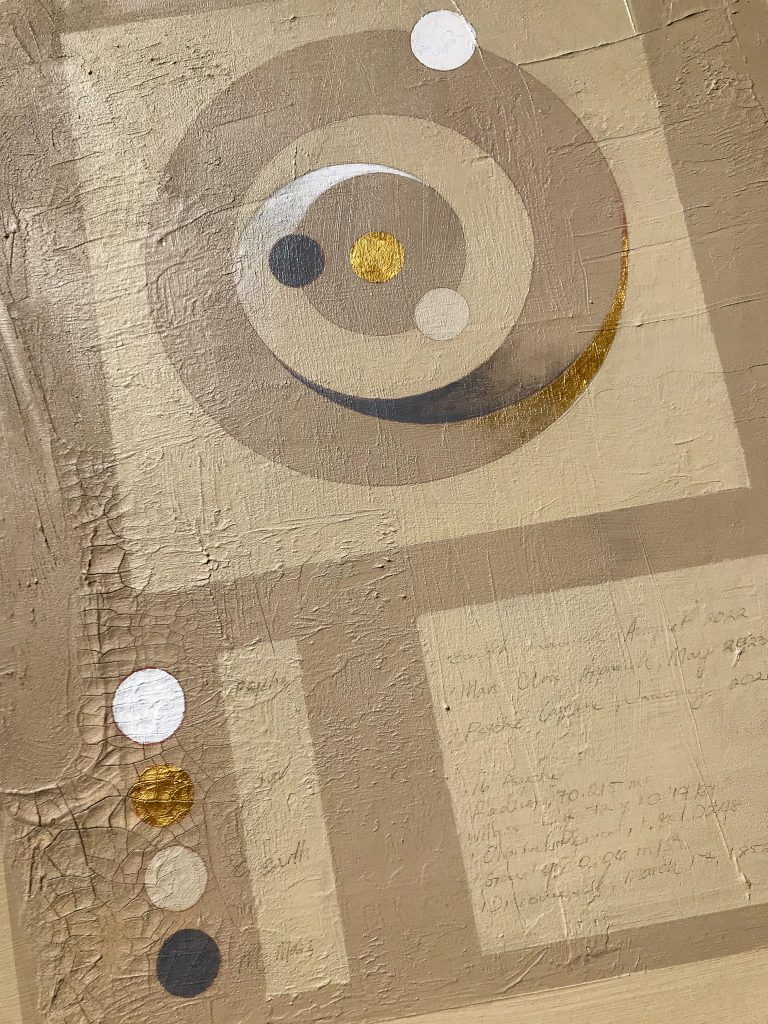 A tan 36'' x 36'' painting with a sheet of brass and aluminum. In the left hand top corner, details of the Psyche asteroid are written underneath the brass sheet. On the top right corner is a sheet of aluminum, and beneath it is a slab of dark grey sand. These elements represent the possible make-up of the Psyche asteroid. In the left hand bottom corner is a diagram of the trajectory of the Psyche mission launch . On the bottom of the image is a 16 Psyche symbol, which consists of a half circle dome with a star on top.