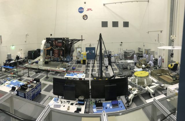 panoramic view of JPL's High Bay 2 area filled with technical equipment and some engineers