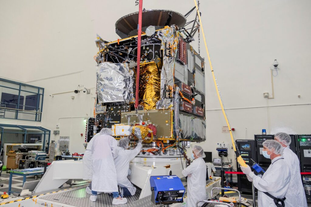 Engineers at NASA's Jet Propulsion Laboratory in Southern California work to integrate Hall thrusters into the agency's Psyche spacecraft in this July 2021 photo. One of the thrusters is visible on the side of the spacecraft beneath a red protective cover. Psyche is set to launch in August 2022 and will travel to its target, a metal-rich asteroid also named Psyche, under the power of solar electric propulsion. This super-efficient mode of propulsion uses solar arrays to capture sunlight that is converted into electricity to power the spacecraft's Hall thrusters. They work by turning xenon gas, a neutral gas used in car headlights and plasma TVs, into xenon ions. As the xenon ions are accelerated out of the thruster, they create the thrust that will propel the spacecraft. This will be the first use of Hall thrusters beyond lunar orbit, demonstrating that they could play a role in supporting future deep space missions. Arizona State University in Tempe leads the Psyche mission. JPL is responsible for the mission's overall management, system engineering, integration and test, and mission operations. Maxar Technologies in Palo Alto, California, supplied the thrusters and built the high-power solar electric propulsion spacecraft chassis. For more information about NASA's Psyche mission, go to: http://www.nasa.gov/psyche or https://psyche.asu.edu/